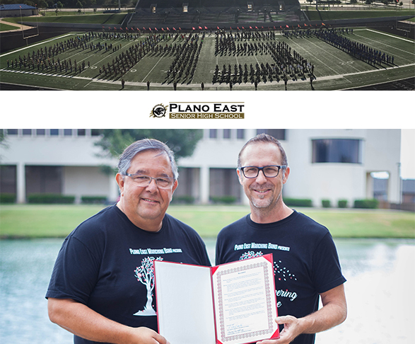 Band directors Evelio Villarreal and John Brennan with board resolution and band spelling EAST